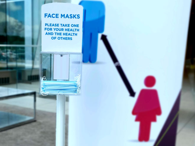 mask dispenser stand in white for lobby or building entrance